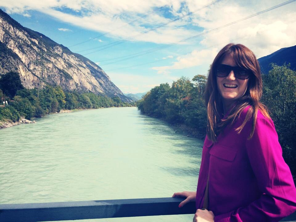 a photo of me smiling widely from a bridge overlooking the Inn River in the Austrian Tyrol.